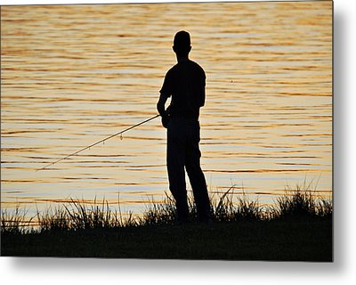 Metal Print featuring the photograph Silhouetted Fisherman by Teresa Blanton