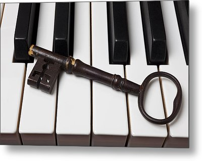 Skeleton Key On Piano Keys Metal Print by Garry Gay