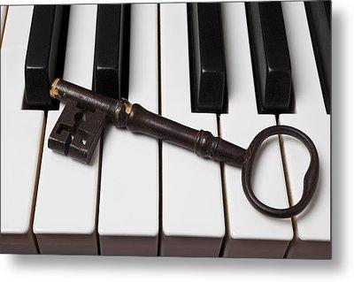 Skeleton Key On Piano Keys Metal Print by Garry Gay