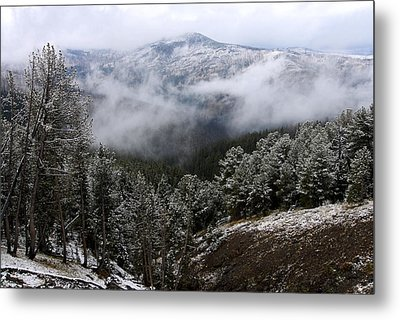 Snow And Clouds In The Mountains Metal Print by Larry Ricker