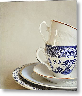 Stacked Blue And White China Cups And Saucers. Metal Print by Lyn Randle