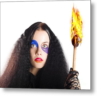 Staring Woman Holding Flame Torch Metal Print