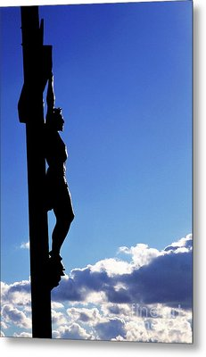 Statue Of Jesus Christ On The Cross Against A Cloudy Sky Metal Print by Sami Sarkis