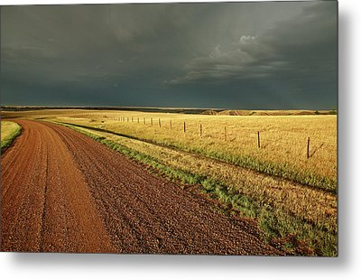 Storm Clouds Along A Saskatchewan Country Road Metal Print by Mark Duffy