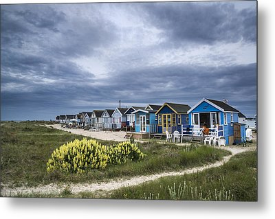 Stormy Sky Over Beach Huts Landscape Metal Print by Matthew Gibson