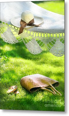 Straw Hat With Brown Ribbon Laying On Hammock Metal Print by Sandra Cunningham