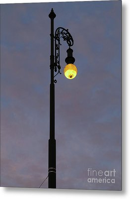 Metal Print featuring the photograph Street Lamp Shining At Dusk by Michal Boubin