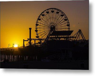 Sun Setting Beyond Ferris Wheel Metal Print