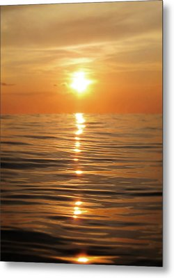 Sun Setting Over Calm Waters Metal Print