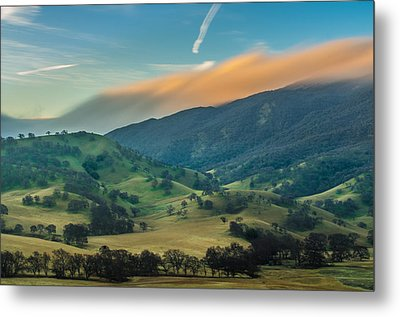 Sunlit Clouds On A Ridge Metal Print by Marc Crumpler