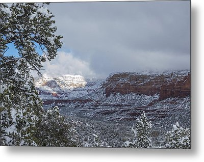 Sunlit Snowy Cliff Metal Print by Laura Pratt