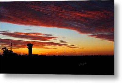 Metal Print featuring the photograph Sunrise Over Golden Spike Tower by Bill Kesler