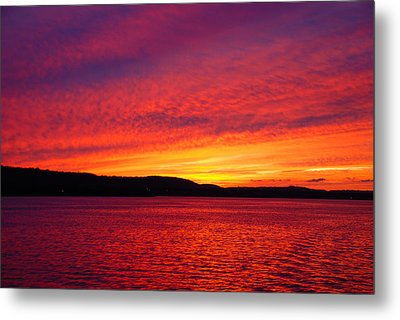 Sunset On Fire Metal Print by Larry Nielson