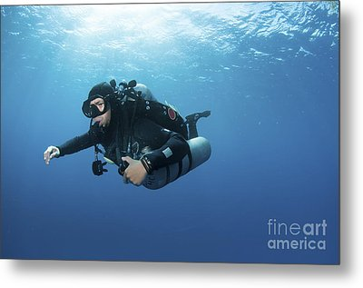 Technical Diver With Equipment Swimming Metal Print by Karen Doody