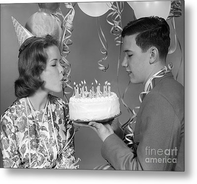 Teen Girl Blowing Out Birthday Candles Metal Print
