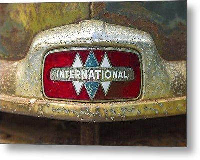 The 1947 International Emblem Ihc Trucks Metal Print by Reid Callaway
