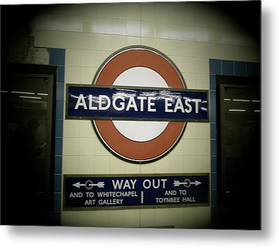 Metal Print featuring the photograph The Tube Aldgate East by Christin Brodie