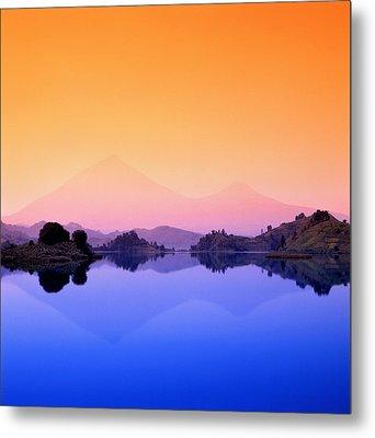 The Virunga Mountains Rise Above Lake Metal Print by David Pluth