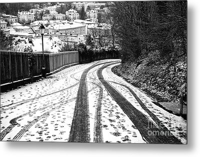 Tire Tracks In The Snow Metal Print by John Rizzuto