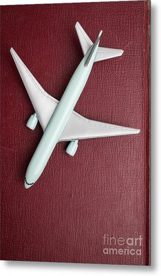 Metal Print featuring the photograph Toy Airplane Over Red Book Cover by Edward Fielding