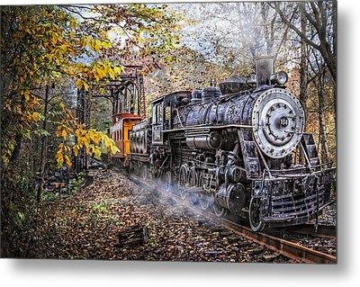 Train's Coming Metal Print by Debra and Dave Vanderlaan