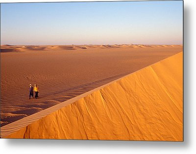 Tuaregs Catch Up To Their Camel Caravan Metal Print by Michael S. Lewis