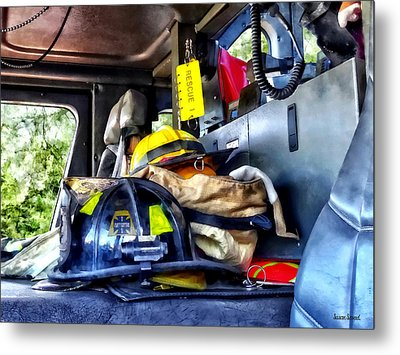 Two Firefighter's Helmets Inside Fire Truck Metal Print by Susan Savad