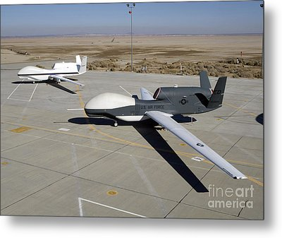 Two Global Hawks Parked On A Ramp Metal Print by Stocktrek Images