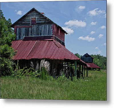 Two Tobacco Barns Metal Print by Sandra Anderson