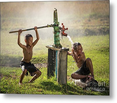 Two Young Boy Rocking Groundwater Bathe In The Hot Days. Metal Print by Tosporn Preede