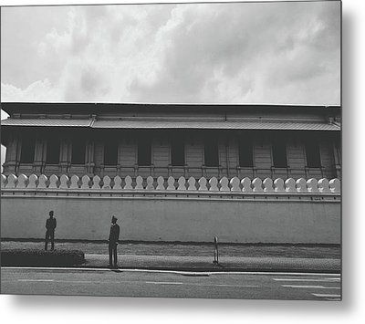 Unknown Men Standing With Long Building Behind Traditional Style Wall  Metal Print