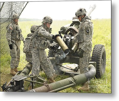U.s. Army Soldier Throws A Spent 105mm Metal Print by Stocktrek Images