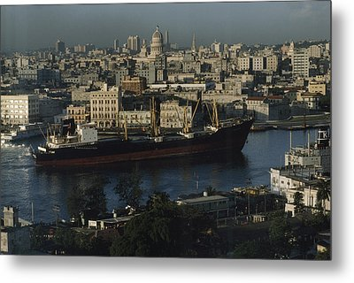 View Of City And A Massive Freighter Metal Print by James L. Stanfield