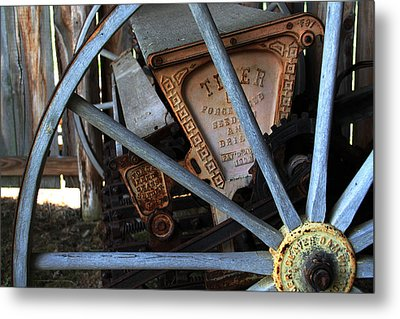 Metal Print featuring the photograph Wagon Wheel And Grass Seeder by Joanne Coyle