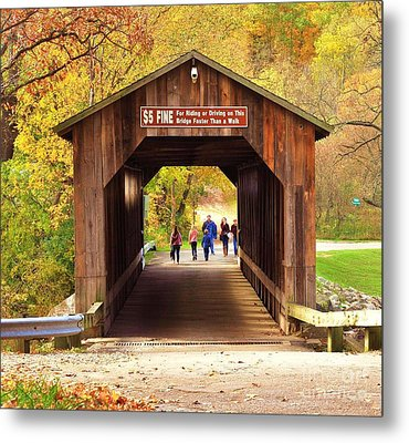 Walking The Historic Fallasburg Covered Bridge Metal Print by Terri Gostola