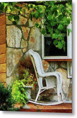Wicker Rocking Chair On Porch Metal Print by Susan Savad