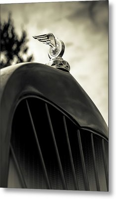 Winged Wheel Metal Print by Caitlyn Grasso
