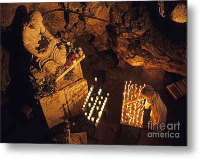 Woman Burning Candle At Troglodyte Sainte-marie Madeleine Holy Cave Metal Print by Sami Sarkis