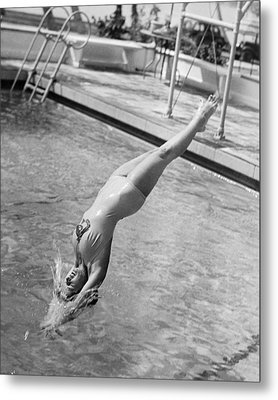 Woman Doing A Back Dive Metal Print by Underwood Archives