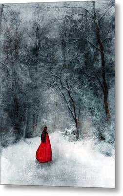 Woman In Red Cape Walking In Snowy Woods Metal Print by Jill Battaglia