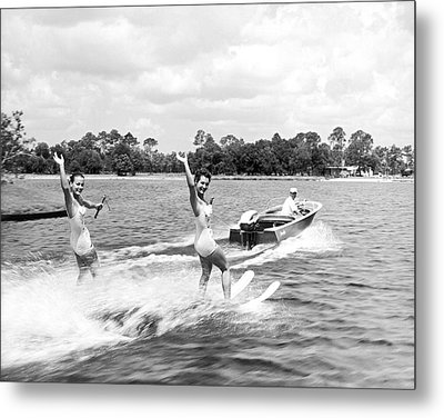 Women Water Skiers Waving Metal Print by Underwood Archives