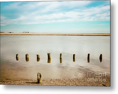 Metal Print featuring the photograph Wood Pilings In Shallow Waters by Colleen Kammerer