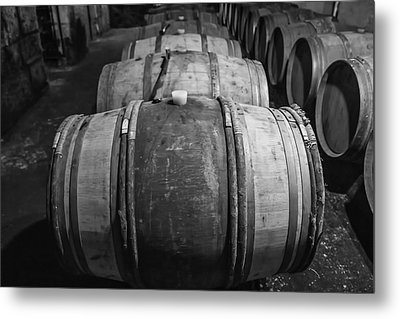 Wooden Barrels In A Wine Cellar Metal Print by Georgia Fowler