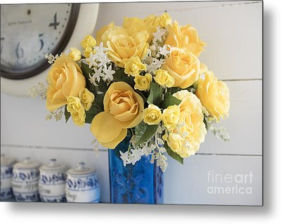 Yellow Flowers In A Blue Vase Metal Print by Juli Scalzi