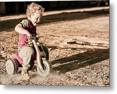 Young Boy Breaking At Fast Pace On Toy Bike Metal Print