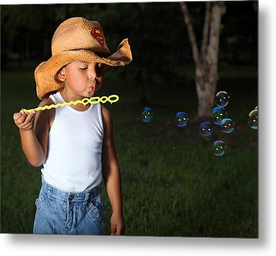 Young Cowboy Blowing Bubbles Metal Print