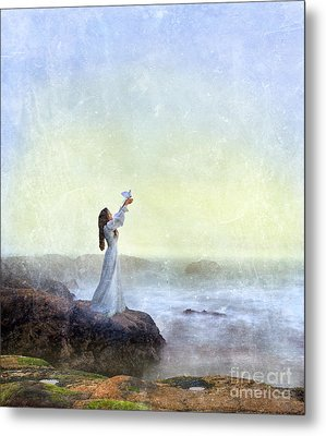 Young Lady Releasing A Dove By The Sea Metal Print