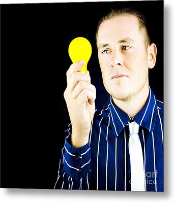 Young Man Holding Light Bulb In Hand Metal Print
