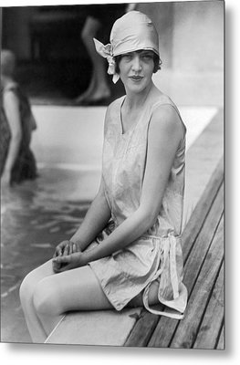 Young Woman Sitting By Pool Metal Print by Underwood Archives