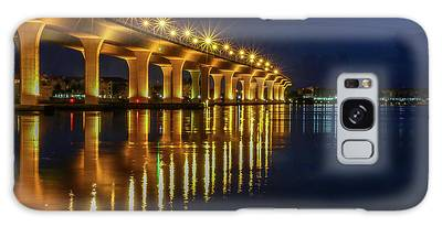 Galaxy Case featuring the photograph Starburst Bridge Reflection by Tom Claud